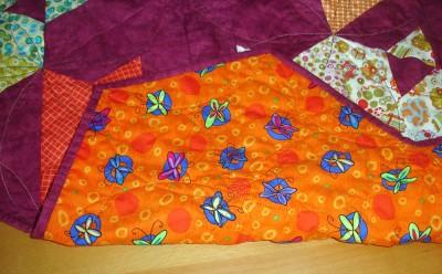 På baksidan blev det orange med fjärilar. Ett fynd från Panduro Outlet.