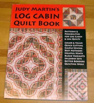 Judy Martins log cabin-bok